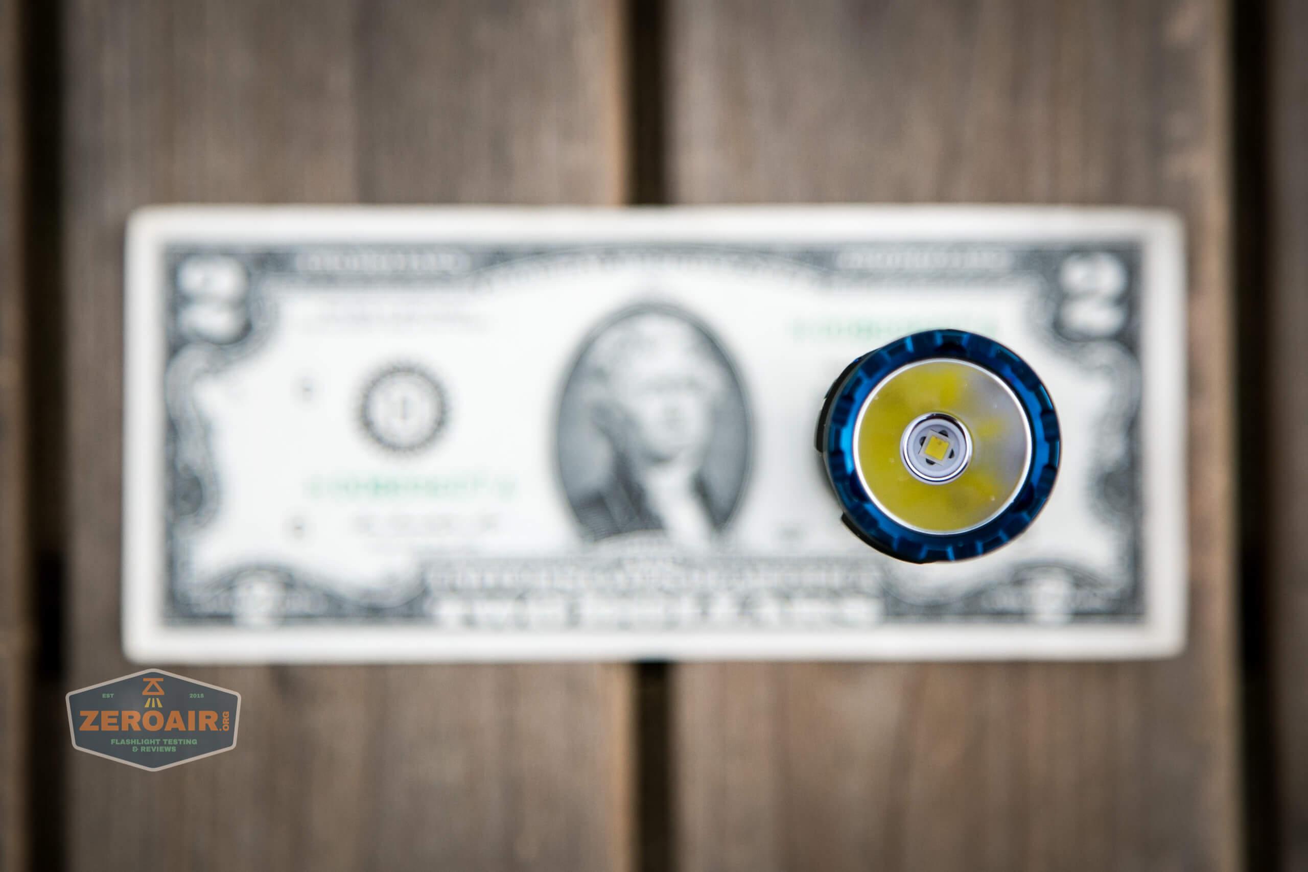 skilhunt m300 18650 flashlight on two dollar bill