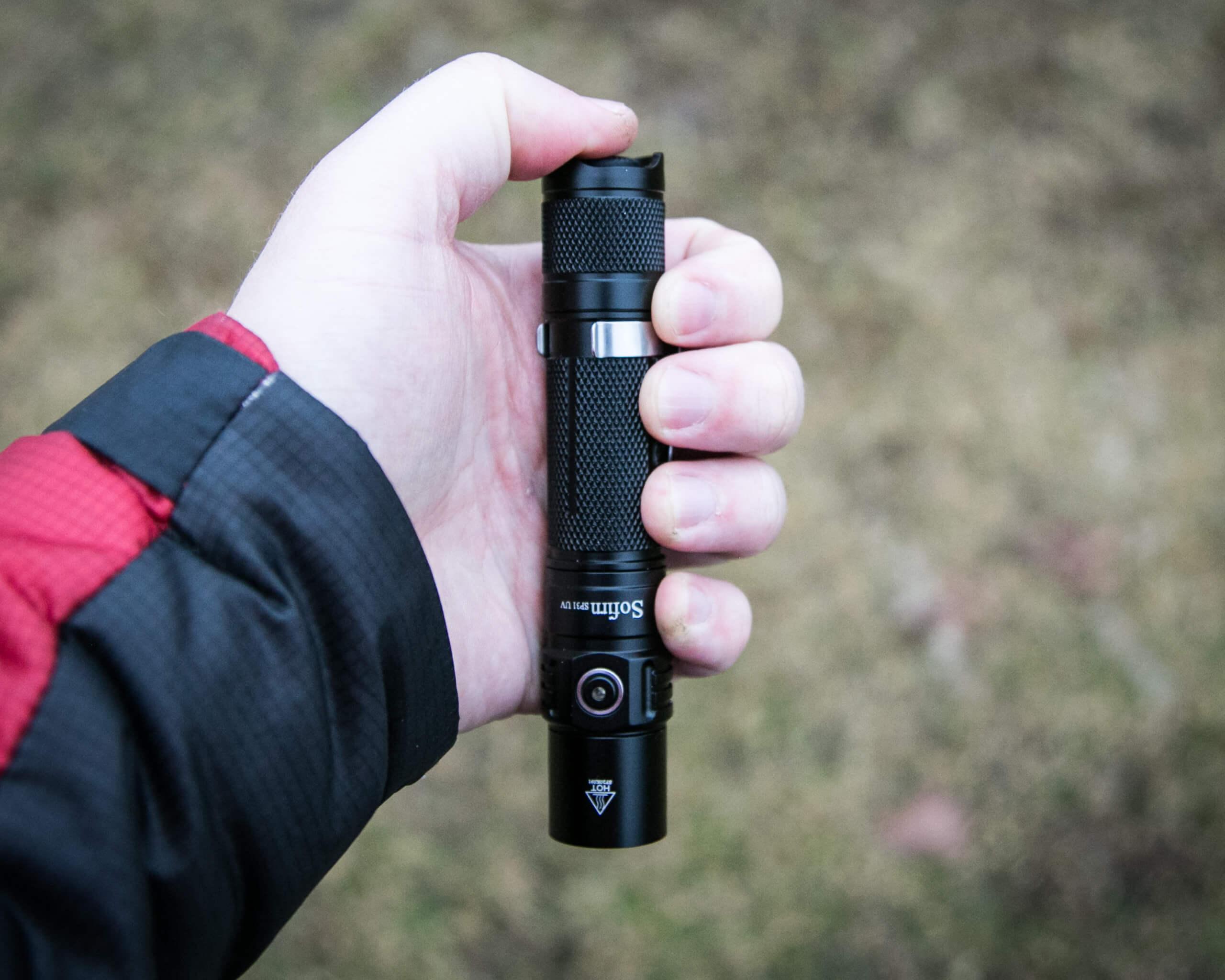 sofirn sp31uv ultraviolet 18650 flashlight in hand