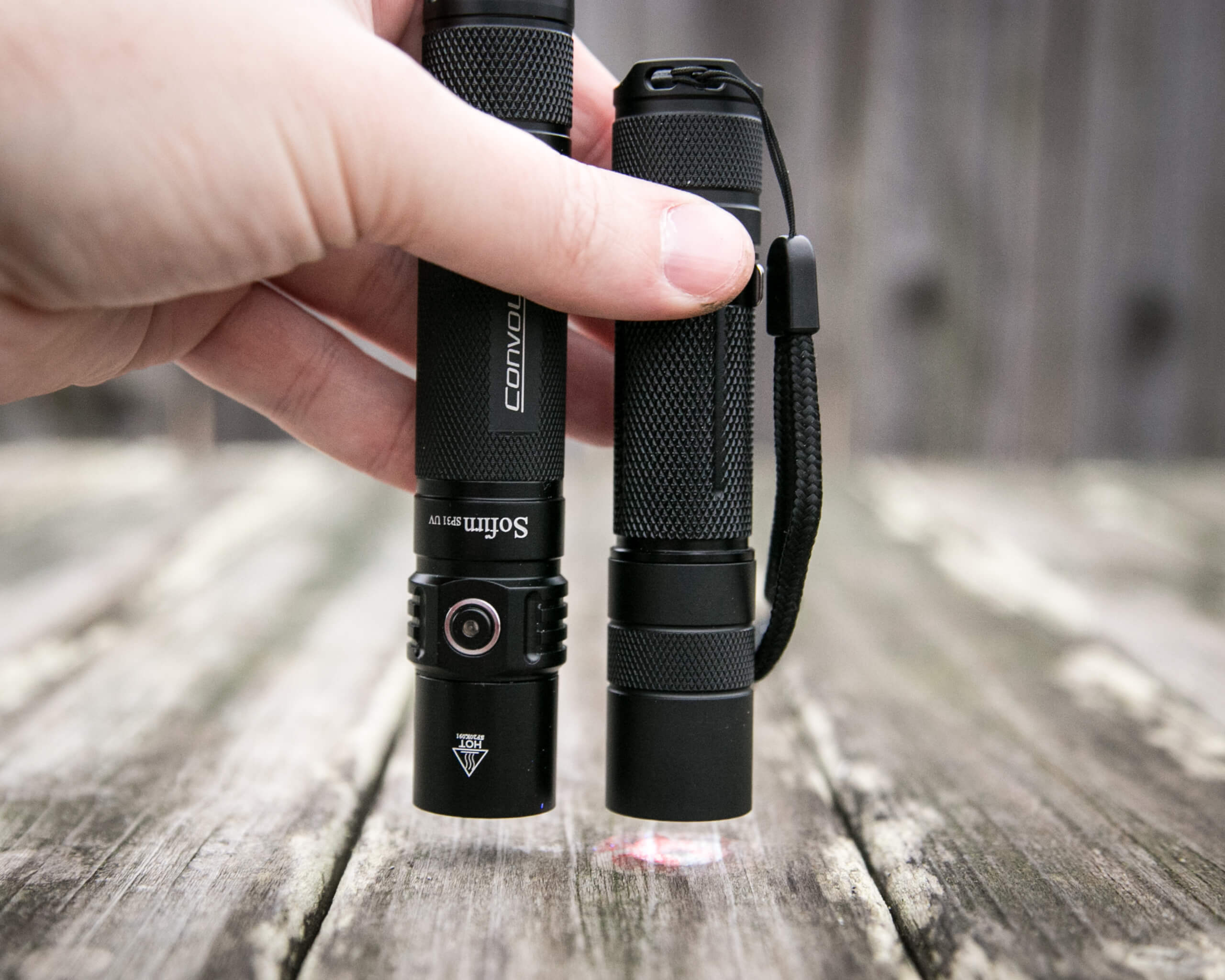sofirn sp31uv ultraviolet 18650 flashlight beside convoy s2+ uv