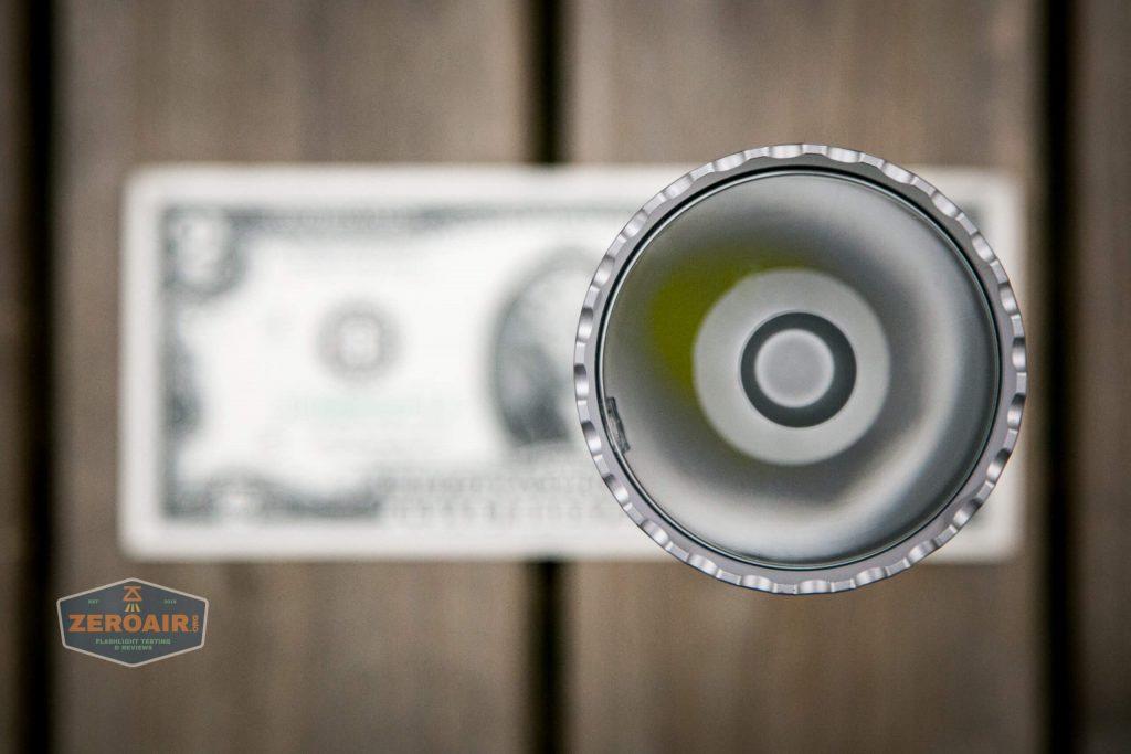 acebeam l19 on two dollar bill