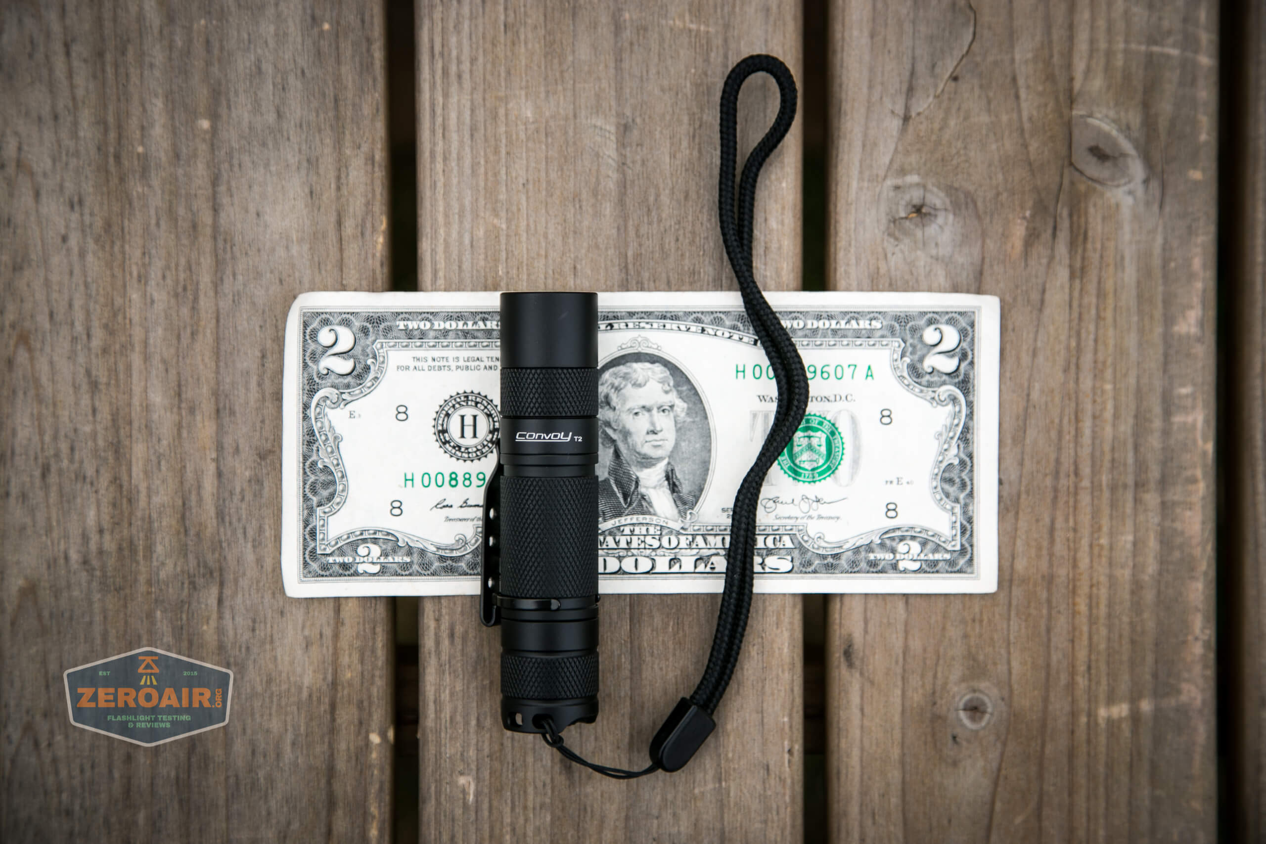 convoy t2 updated 14500/AA flashlight on two dollar bill