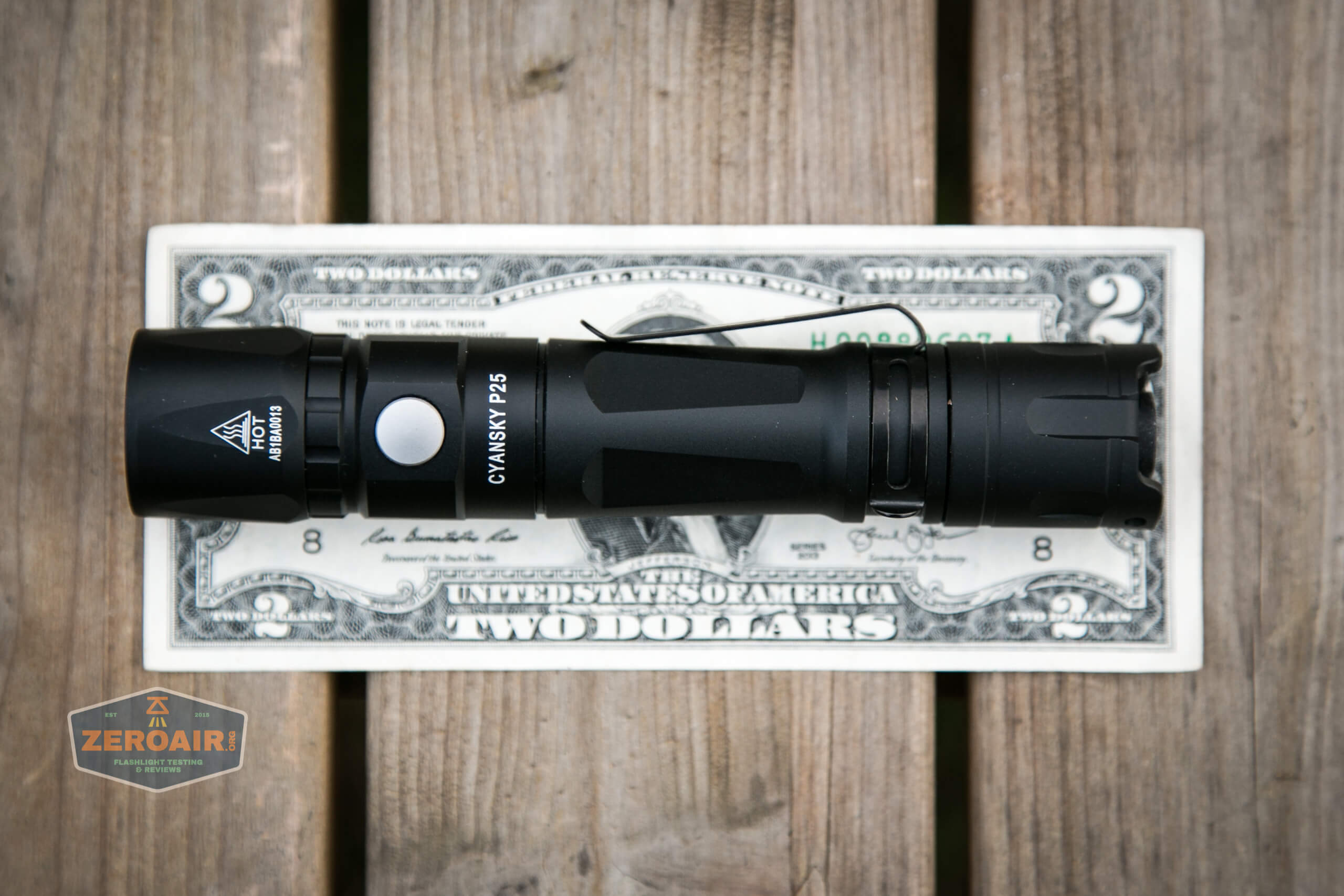 Cyansky P25 Flashlight on two dollar bill