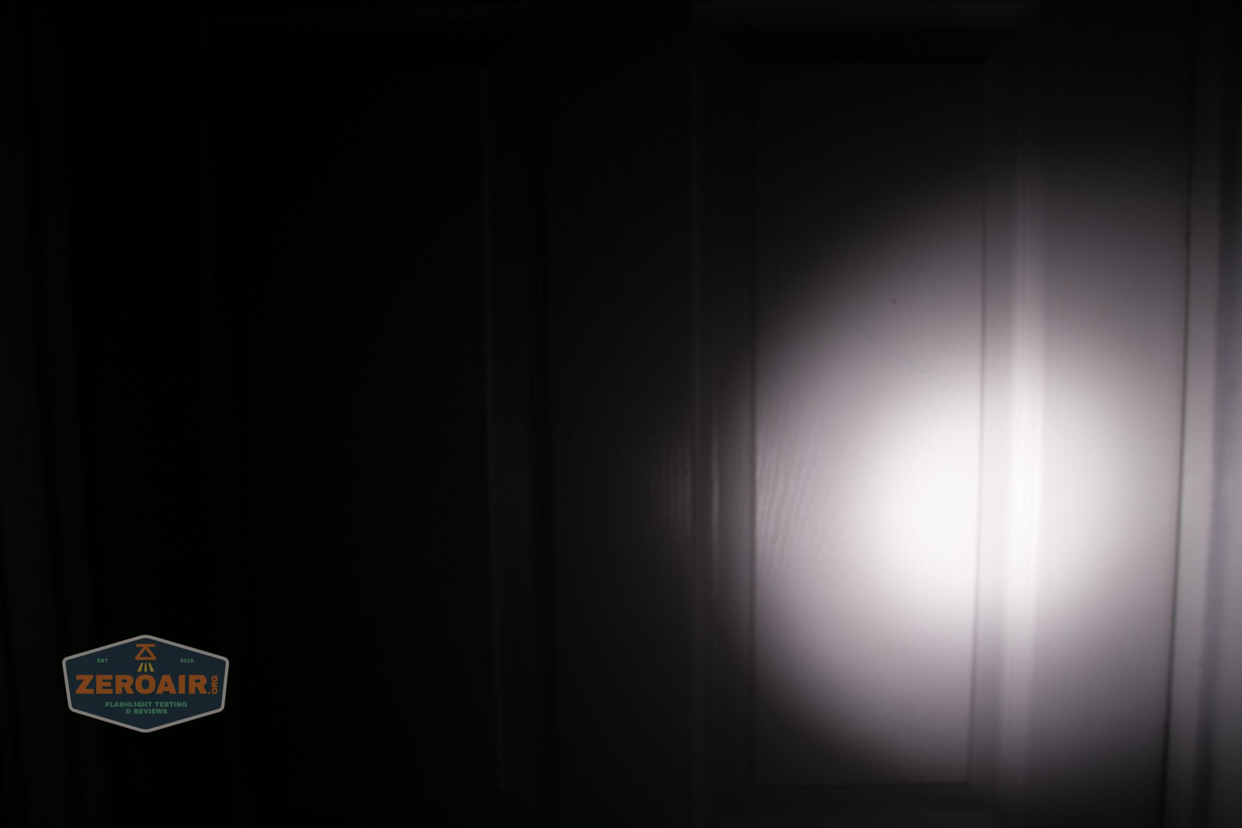Manker MC13 thrower flashlight beamshot door 2