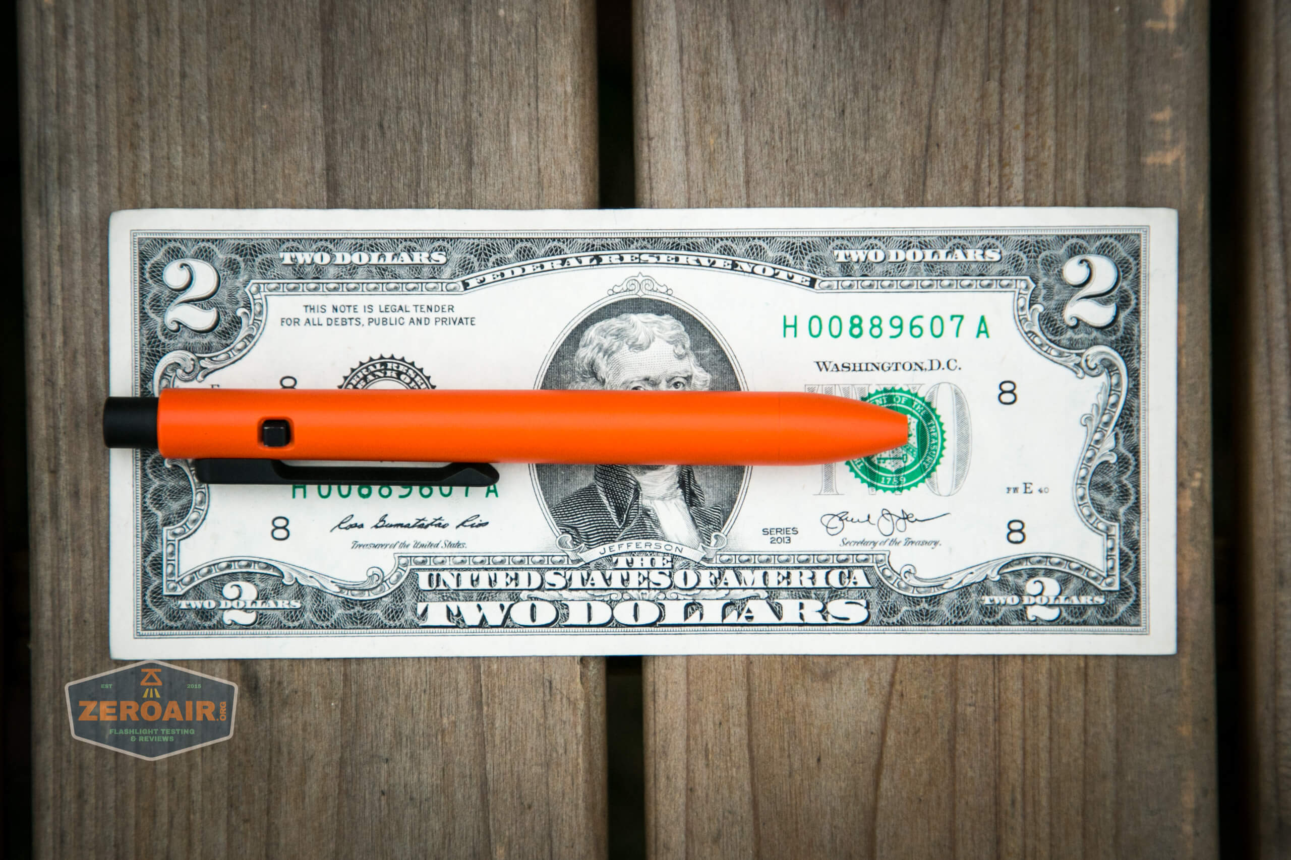 tactile turn side click pen safety first on two dollar bill