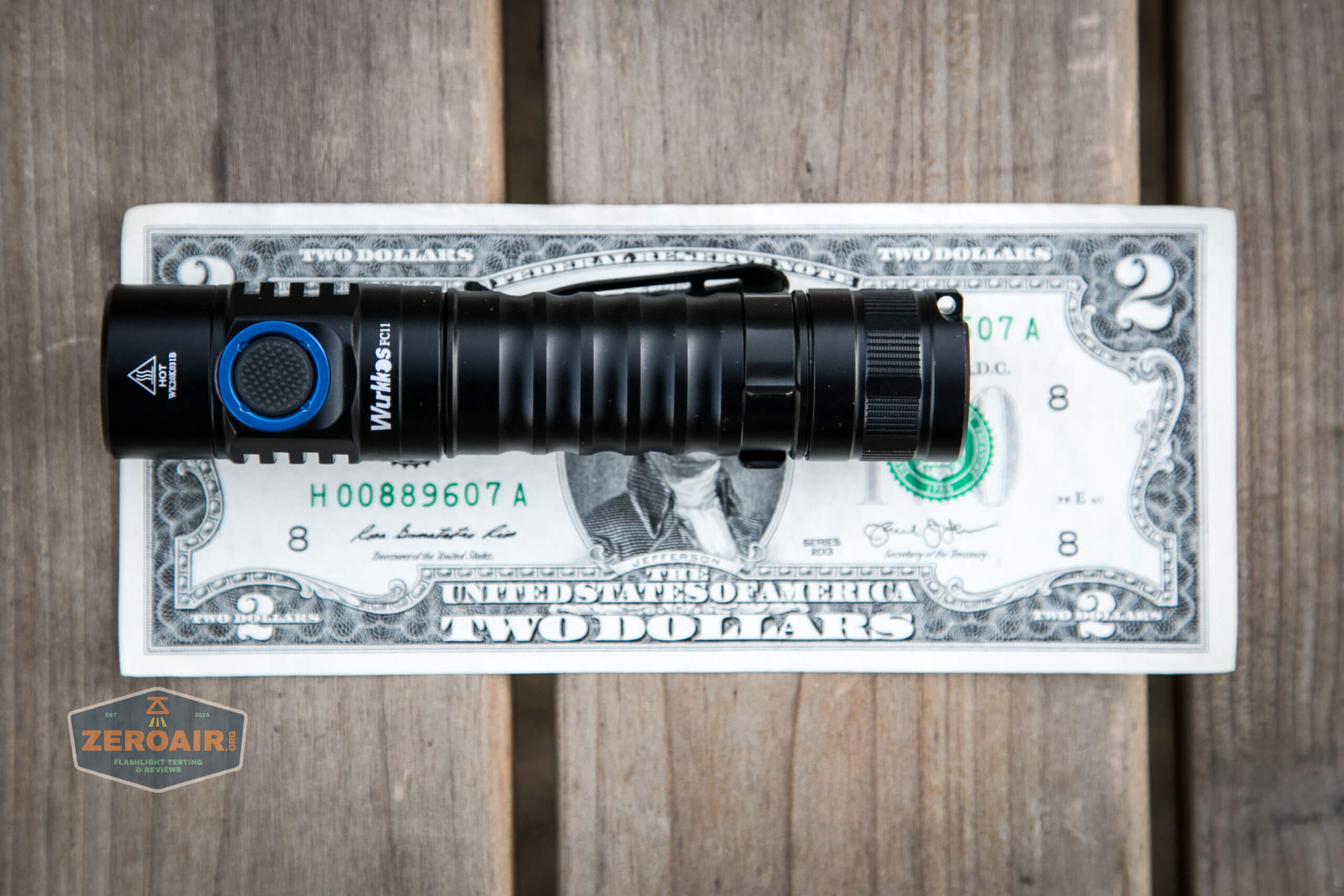 wurkkos fc11 flashlight on two dollar bill