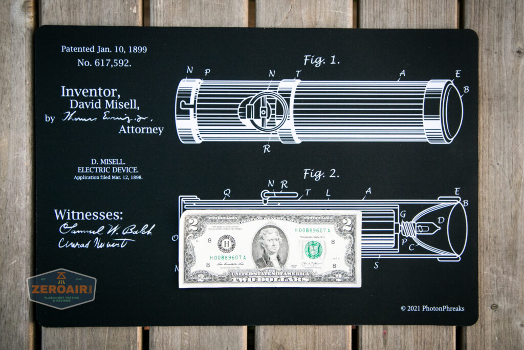 two dollar bill on mat