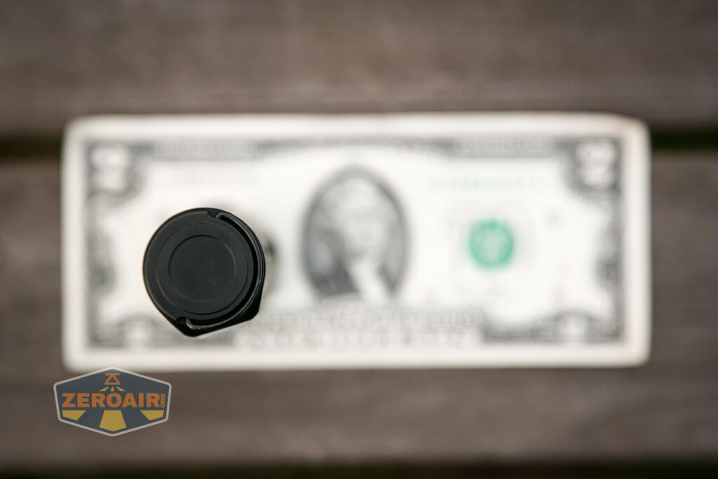 Lumintop E21C Flashlight on two dollar bill
