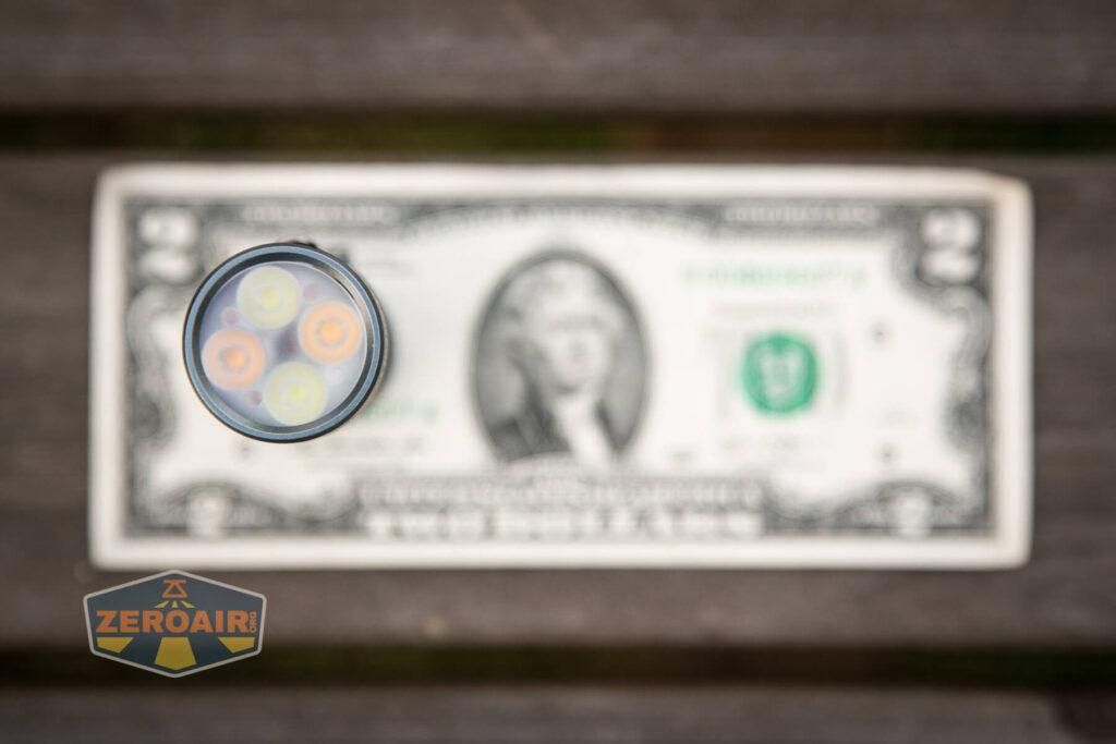 Lumintop FW4X Flashlight on two-dollar bill