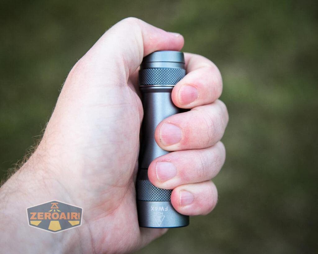 Lumintop FW4X Flashlight in-hand