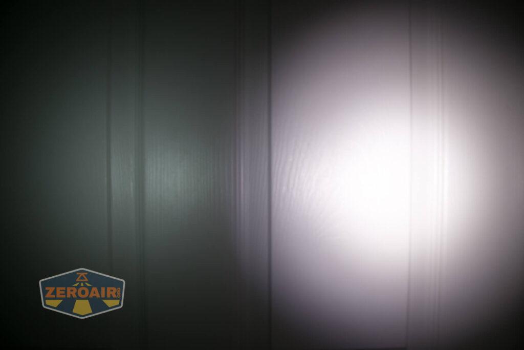 Lumintop FW4X Flashlight beamshots on door compared to nichia 219b