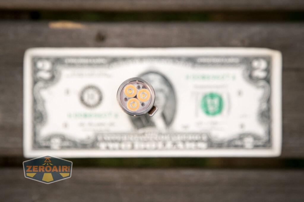 Lumintop FWAA TiCU 14500 flashlight on two-dollar bill