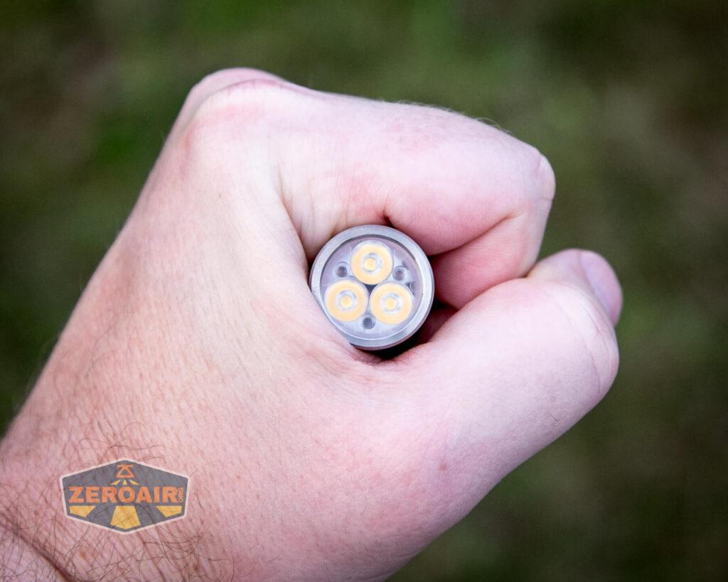 Lumintop FWAA TiCU 14500 flashlight in hand