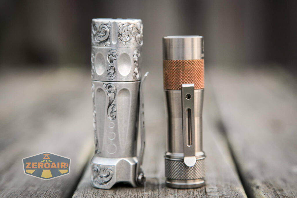 Lumintop FWAA TiCU 14500 flashlight beside torchlab boss 35
