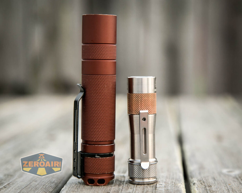 Lumintop FWAA TiCU 14500 flashlight beside convoy s2+