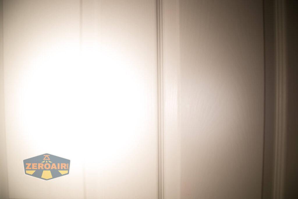 Lumintop FWAA TiCU 14500 flashlight beamshots on door compared to nichia 219b