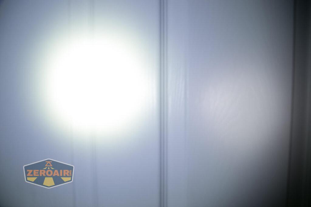 Nicron H15 Headlamp beamshots on door compared to nichia 219b