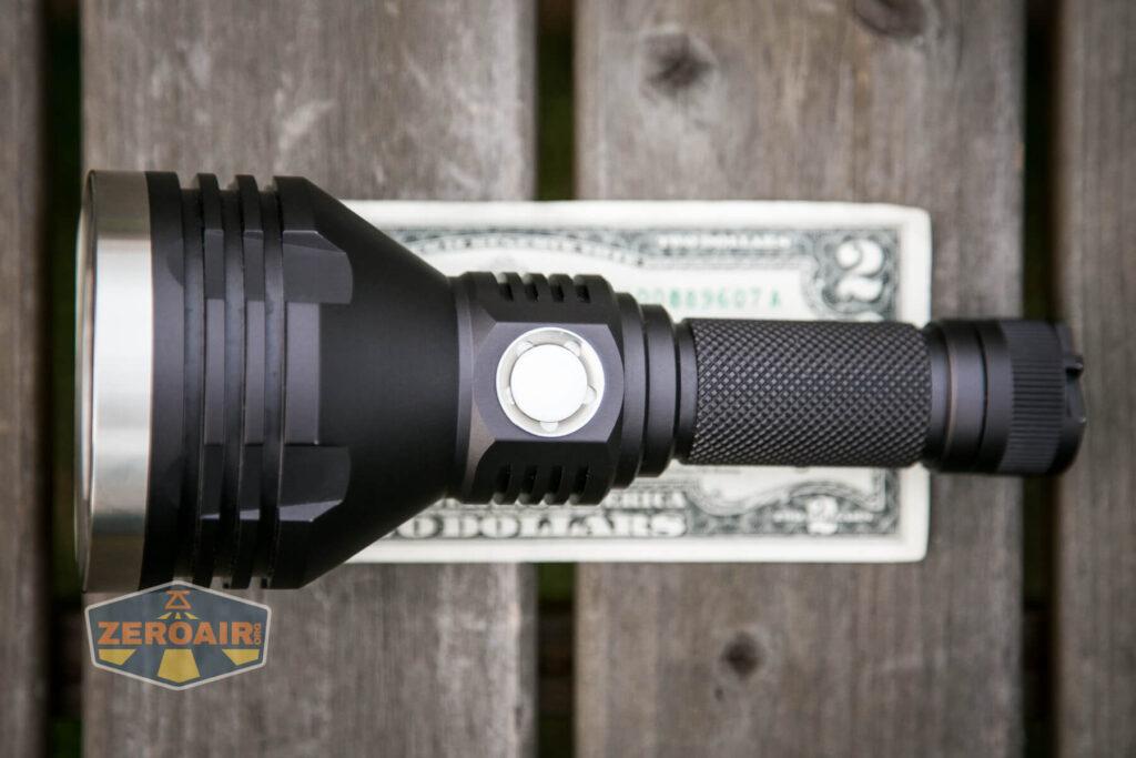 Noctigon K1 21700 Flashlight on two dollar bill