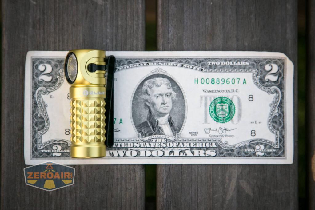 Olight Perun Mini Kit Headlight on two-dollar bill
