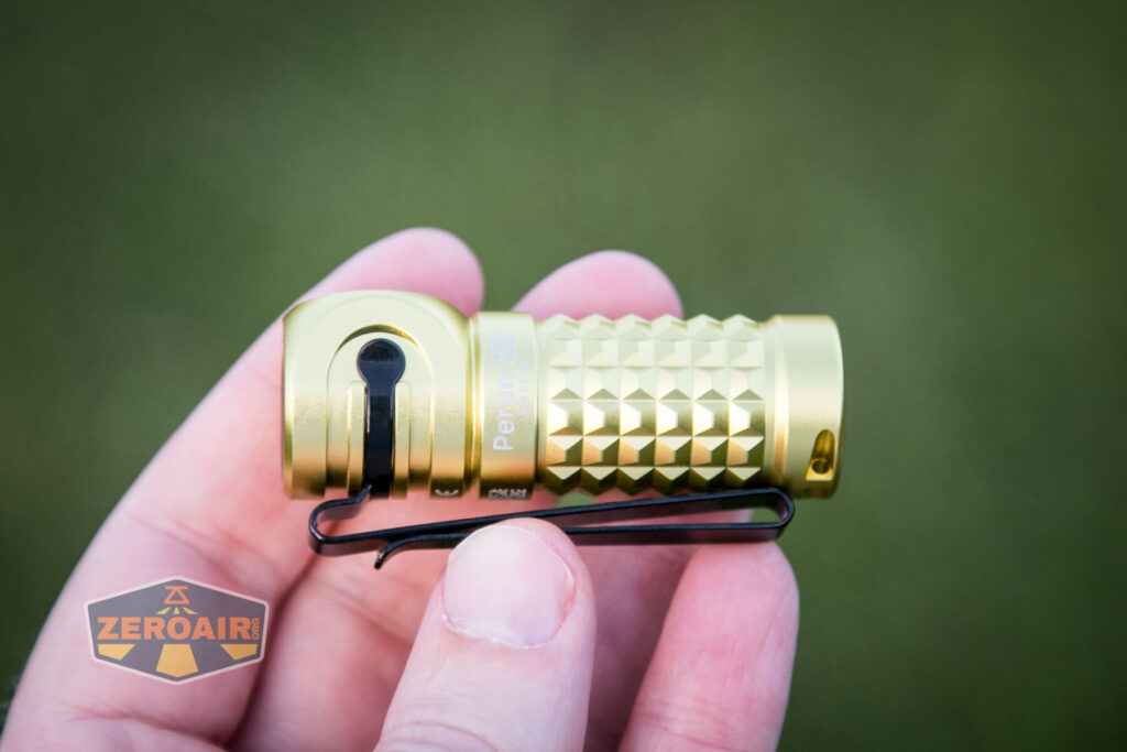Olight Perun Mini Kit Headlight in hand