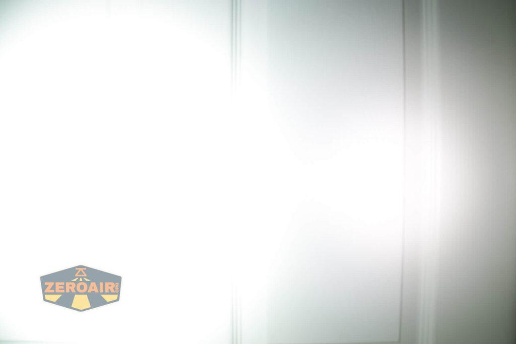 Olight Perun Mini Kit Headlight beamshot door compared to nichia 219b