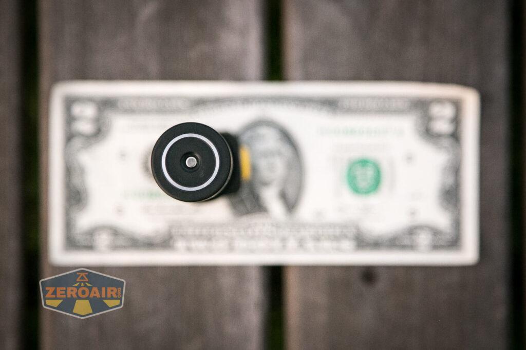 Armytek Wizard C2 WUV Headlamp on two-dollar bill