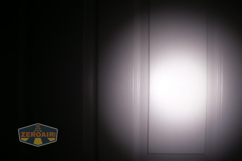 Armytek Wizard C2 WUV Headlamp beamshot on door compared to nichia 219b