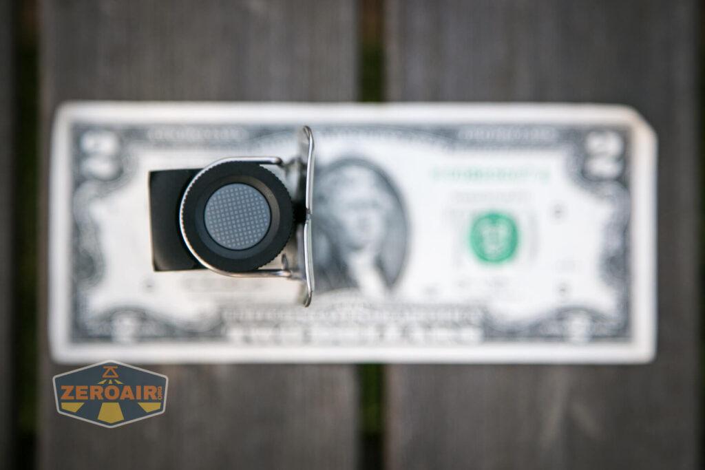 Cyansky HS6R headlamp on two-dollar bill