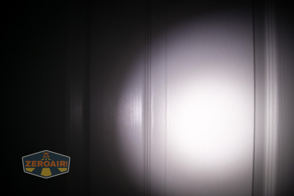 Olight X9R Cell door beamshot compared to nichia 219b